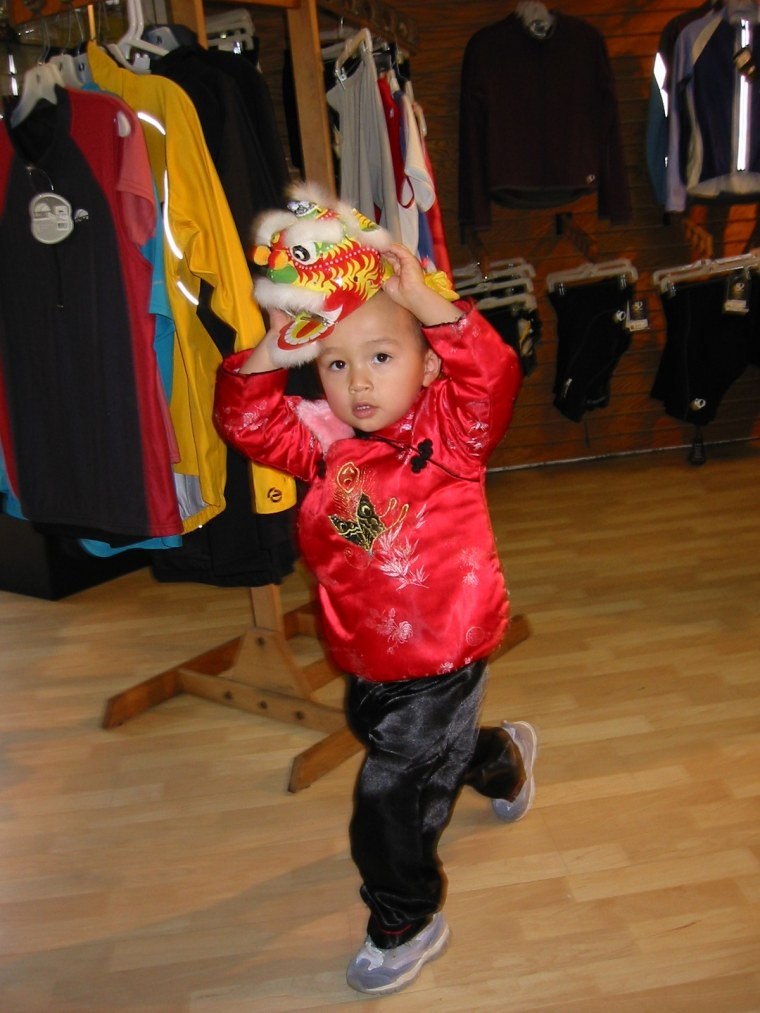 Frances Kai-Hwa Wang's son with a lion dance costume.