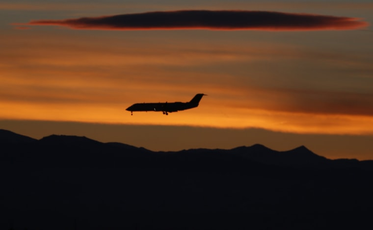 Image: Airplane lands at Denver International Airport