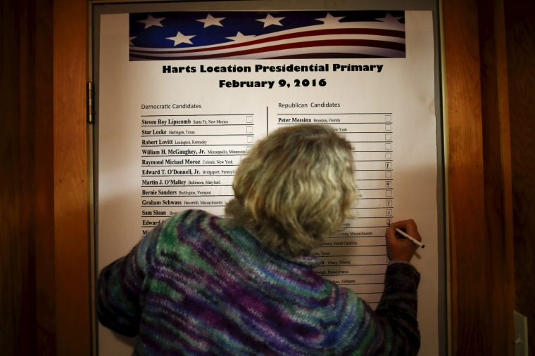 Image: An official labels the number of votes candidates received in New Hampshire's first-in-the-nation primary in Hart