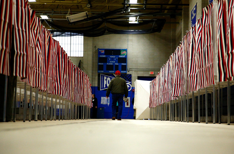 Image: People vote at a polling place at Merrimack High School in Merrimack