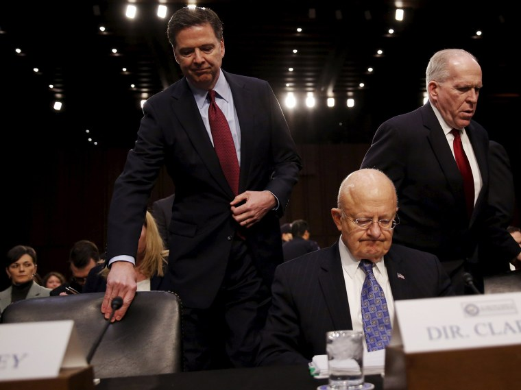 Image: FBI Director James Comey, Director of National Intelligence James Clapper and CIA Director John Brennan
