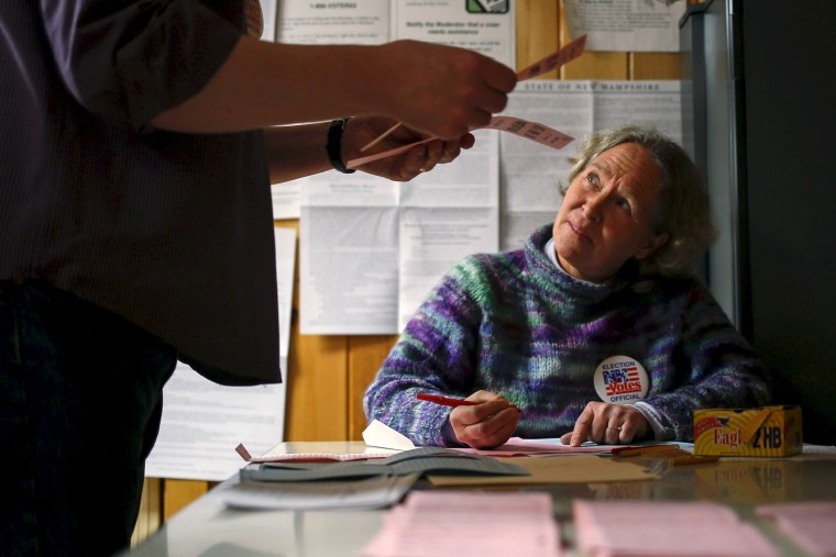 Image: Officials count ballots in New Hampshire's first-in-the-nation primary at the town hall in Hart's Location