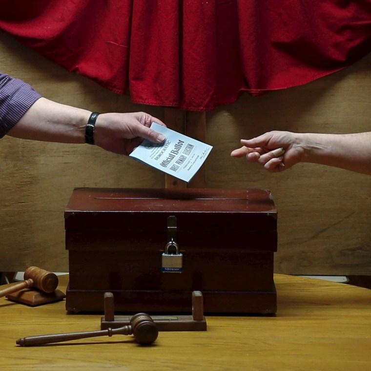 Image: Town moderator casts a ballot