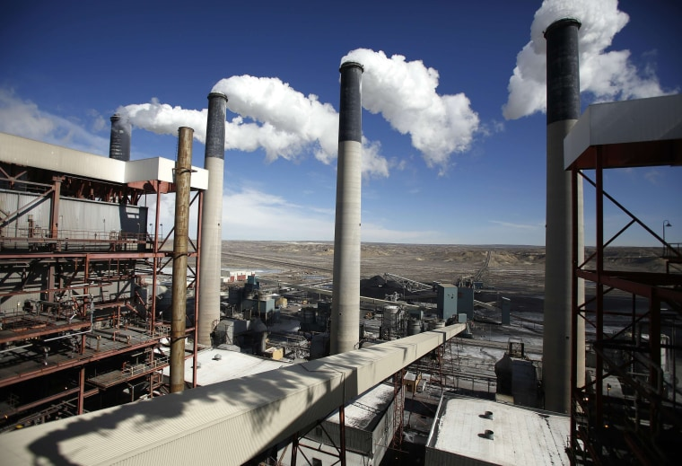 Image: Steam rises from the stakes of the coal fired Jim Bridger Power Plant outside Point of the Rocks, Wyoming