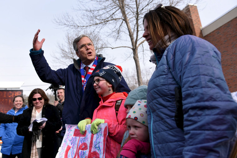 Image: U.S. Republican presidential candidate, Governor Jeb Bush meets the Quigly family of Manchester; Charley, 11, Ellie, 7, Tula, 5 and mom, Chris Quigley while stopping at the Manchester precinct, Webster Elementary School in Manchester