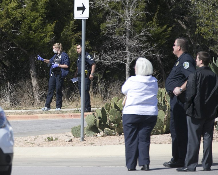 Image: Austin Police Department officers investigate the scene of an officer involved shooting