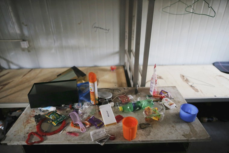 Image: Possessions of a migrant worker are seen at his accommodation at the construction site of Zixia Garden development complex in Qianan, Tangshan City
