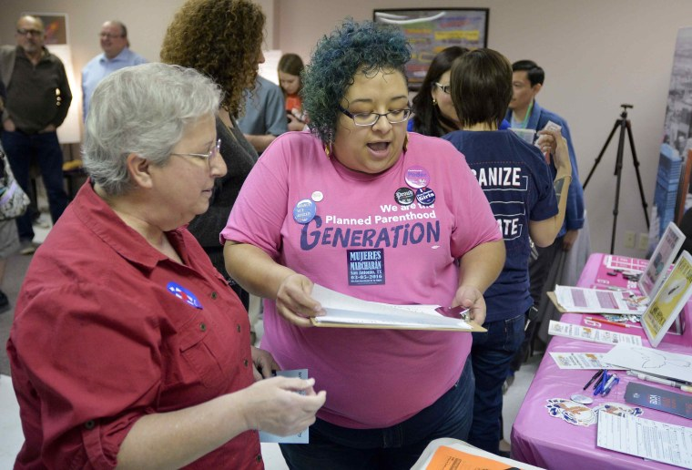 "Women's reproductive rights supporter Elisa Gonzalez (L) speaks with Planned Parenthood volunteer Barbie Hurtado during a media tour of the Whole Woman's Health clinic in San Antonio, Texas, February 9, 2016.  As the U.S. Supreme Court prepares to decide the legality of strict Texas abortion restrictions, women's healthcare providers have launched a campaign across the state trying to win support to keep their clinics open. On Tuesday, one of the plaintiffs in the suit, Whole Woman's Health, opened a San Antonio clinic to media as part of week-long campaign of rallies called the ""Truth Tour."""