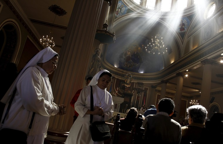 Image: Nuns attend a mass during the traditional Ash Wednesday service, at the Metropolitan Cathedral in San Jose