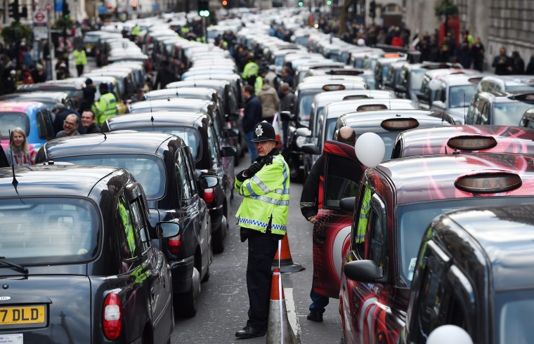 Image: Black cabs protest against Uber licence in London