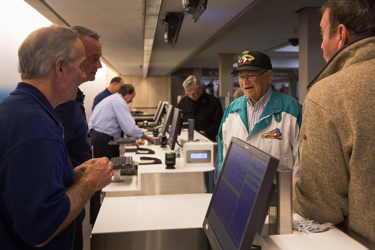 Image: Norwood Thomas, a 93-year-old World War II veteran, answers a question from airline employees