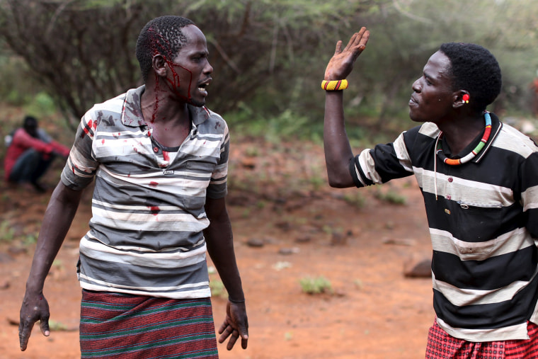 Image: Two men fight over a dispute during an ceremony
