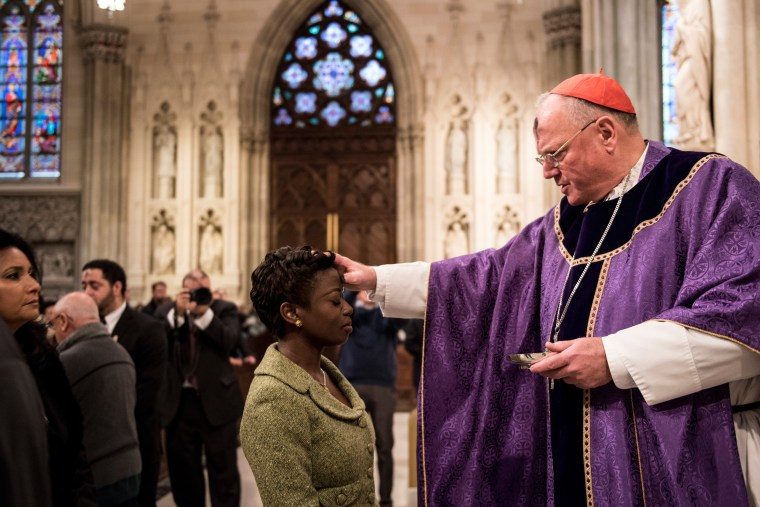 Image: Cardinal Timothy Dolan distributes ashes on Ash Wednesday