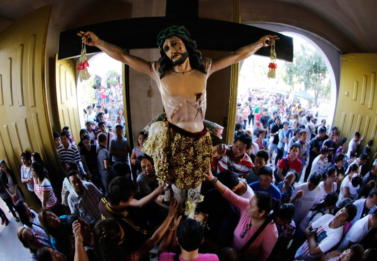 Image: Filipinos with cross markings on their forehead as they attend a Holy Mass