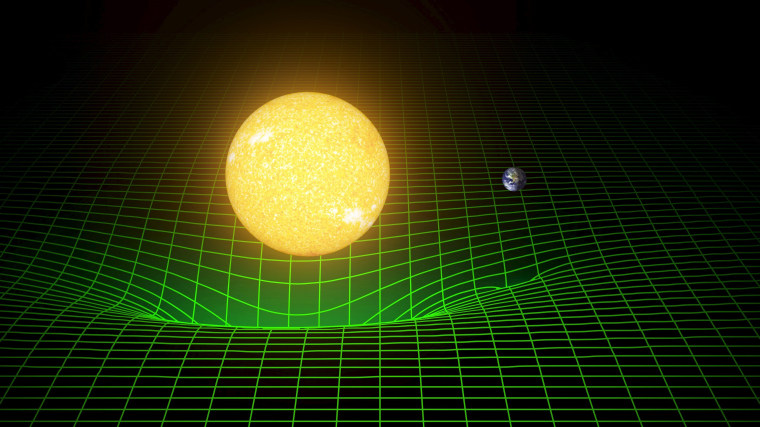 Image: A computer simulation shows how our sun and Earth warp space and time, or spacetime, represented here with a green grid