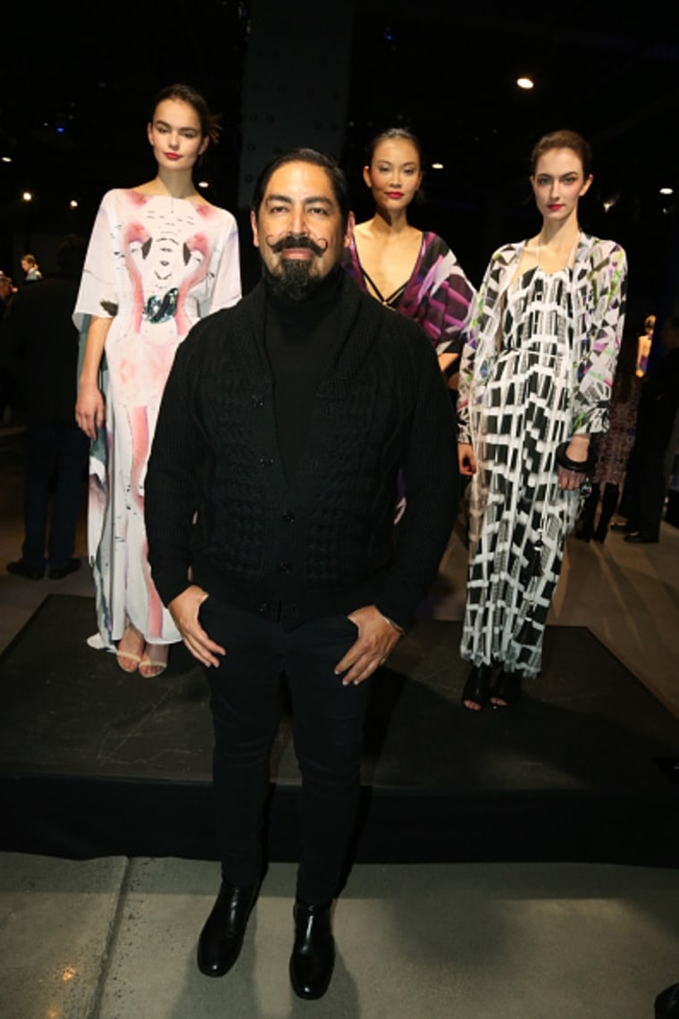 Designer Danny Santiago (center) poses with models wearing his collection.