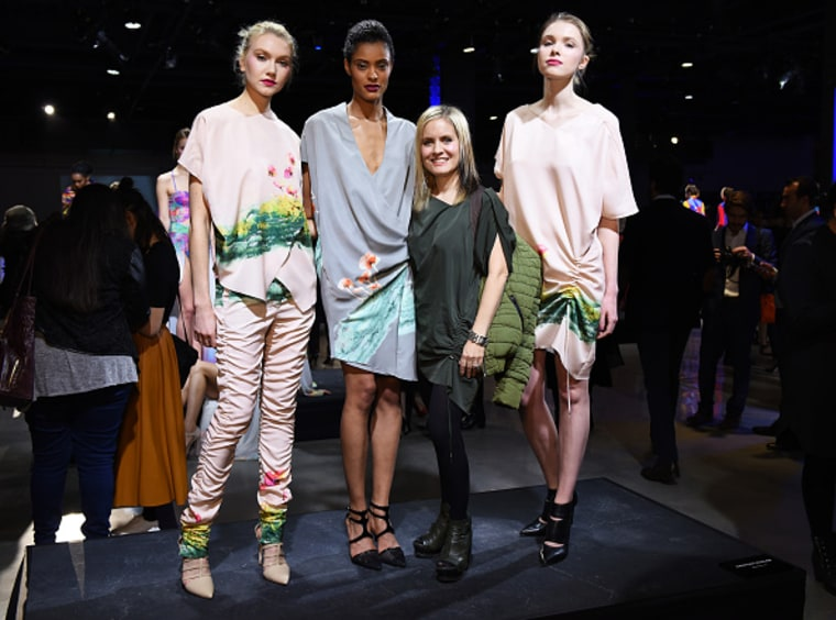 Designer Cristina Ruales poses with models wearing her collection.