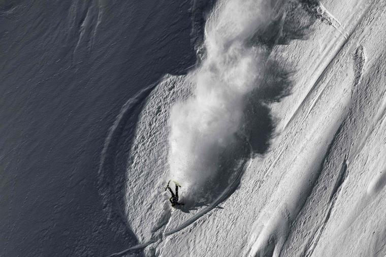Image: U.S. skier Martin Lentz falls as he rides the wild face of l'Aiguille Pourrie