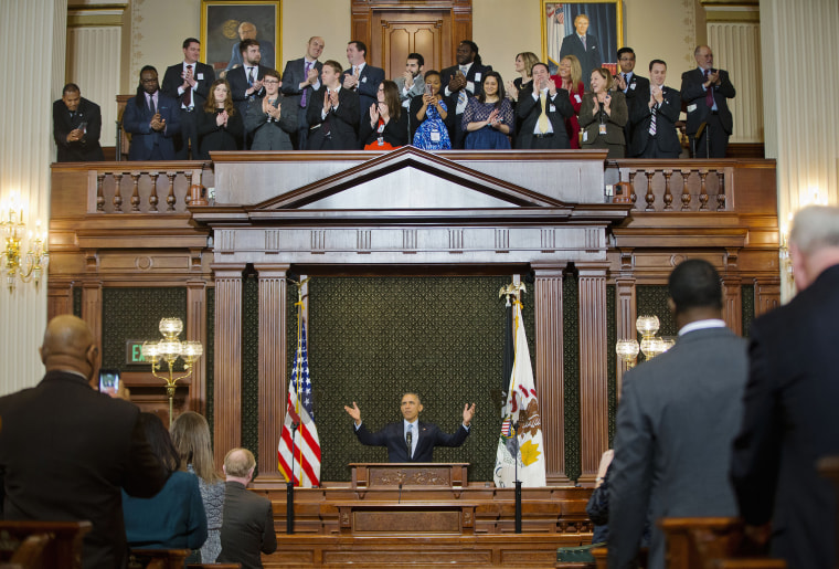 Image: President Barack Obama receives a standing ovation before addressing the Illinois General Assembly