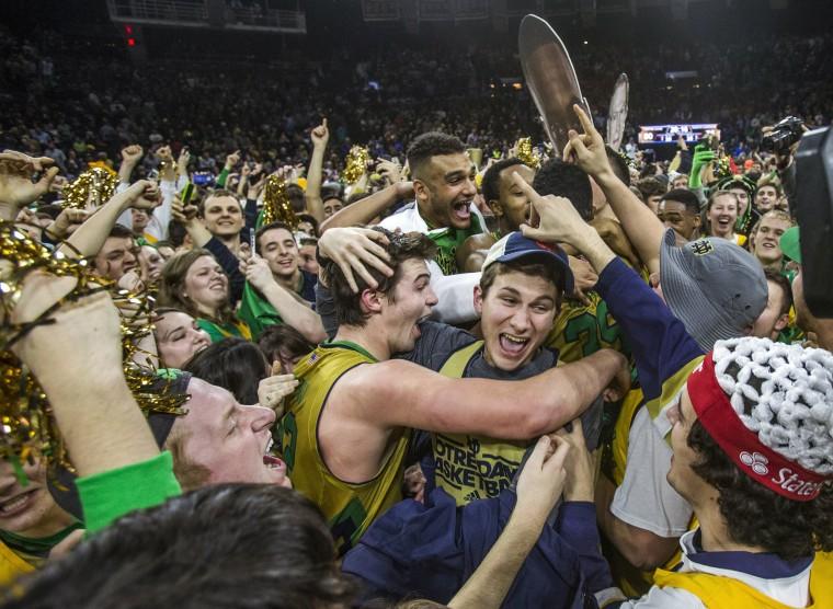 Image: Notre Dame's Steve Vasturia celebrates on the court with fans