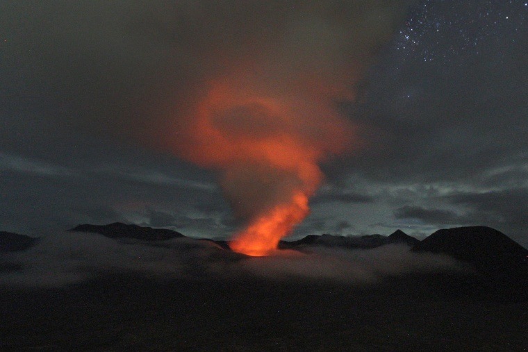 Image: Mount Bromo spews volcanic materials into the air as seen from Ngadisari