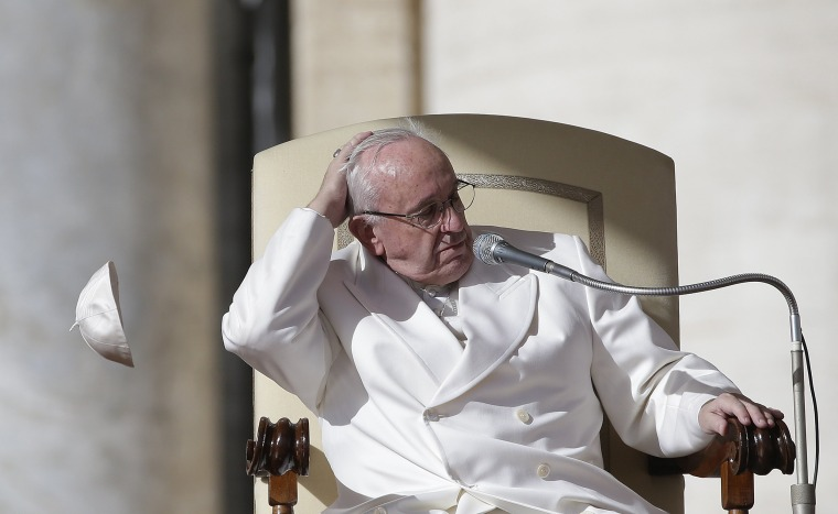 Image: A gust of wind blows away Pope Francis' skullcap during his weekly general audience in Saint Peter's Square at the Vatican
