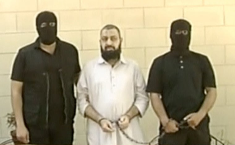 Image: An arrested militant suspect is seen in this still image taken from video