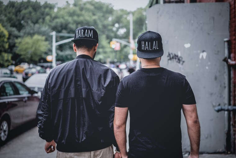 "Hats from Ateeq's first collection featuring the words ""Halal"" and ""Haram."""
