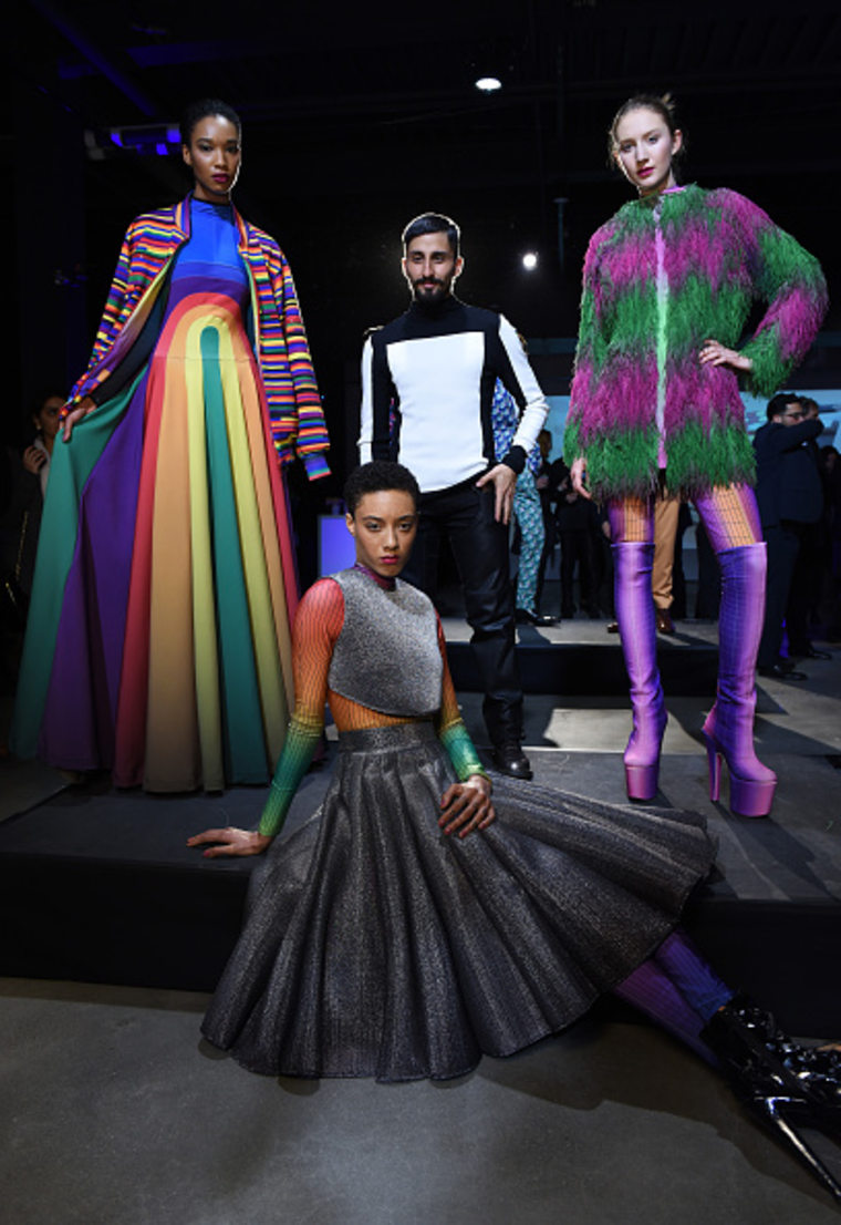 Designer Matías Hernán poses with models wearing his collection.