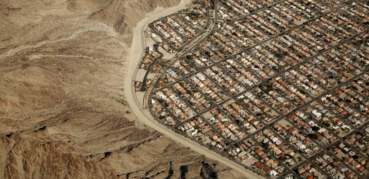 Image: An aerial view shows a densely populated area abuts the desert in the Palm Springs area of California