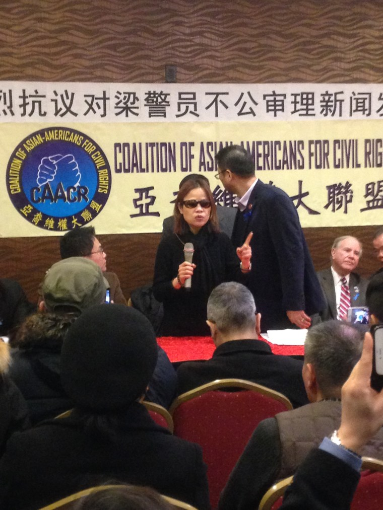 Peter Liang's mother, Fenny Liang, addresses supporters in Mandarin at a press conference, Friday, Feb. 12, 2016, one day after her son, a former NYPD rookie officer, was convicted of manslaughter in the 2014 shooting death of Akai Gurley.