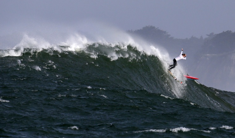 Image: Mark Healey drops off a giant wave during the second heat of the Mavericks surfing contest