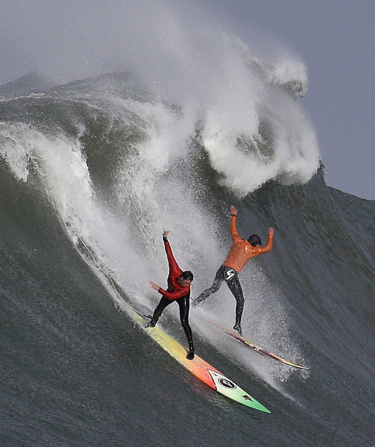 Image:Ken Collins, left, and Tyler Fox surf a giant wave