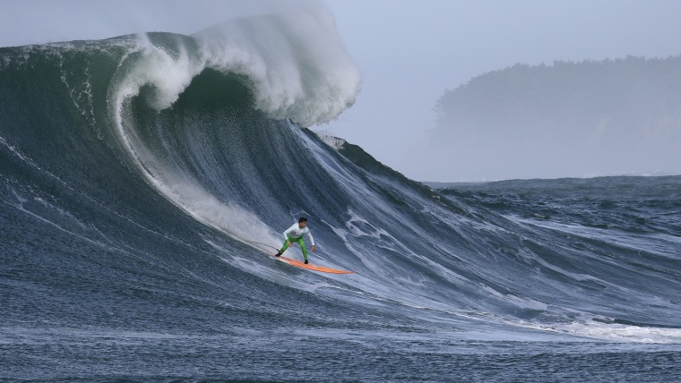 Image: Nic Lamb rides a wave during the fourth heat of the Mavericks surfing contest