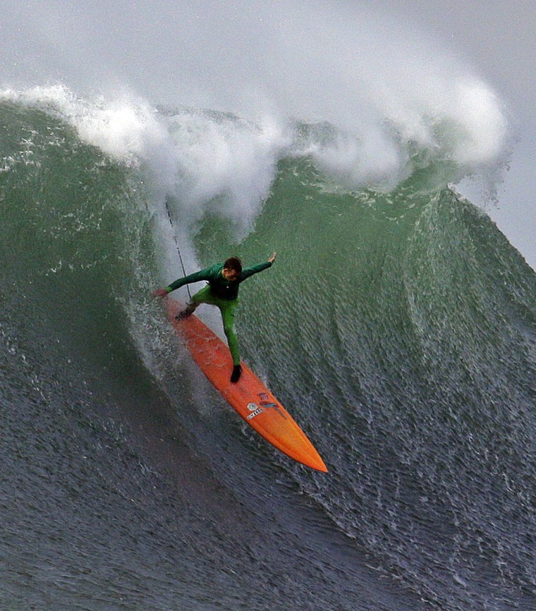 Image: Nic Lamb surfs a giant wave during the finals
