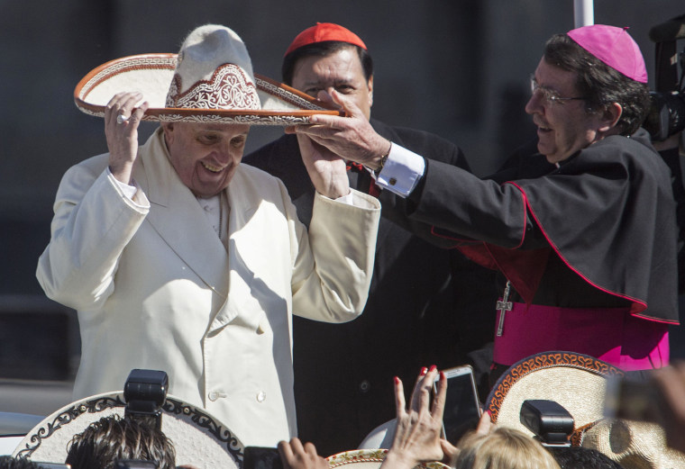 Image: Pope Francis dons a Mexican charro style sombrero that was given to him by a person in the crowd