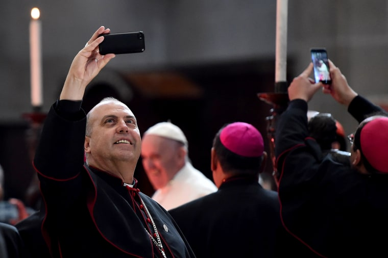 Image: Mexican bishops take snapshots as Pope Francis arrives for a meeting