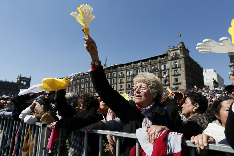 Image: People wait for Pope Francis outside Metropolitan Cathedral