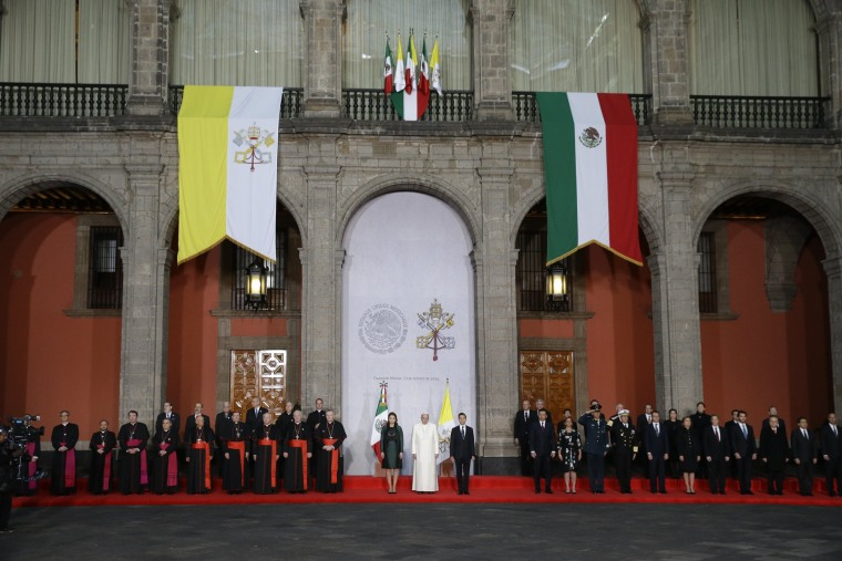 Image: Pope Francis is welcomed by Mexico's President Enrique Pena Nieto, center right, and his wife Angelica Rivera