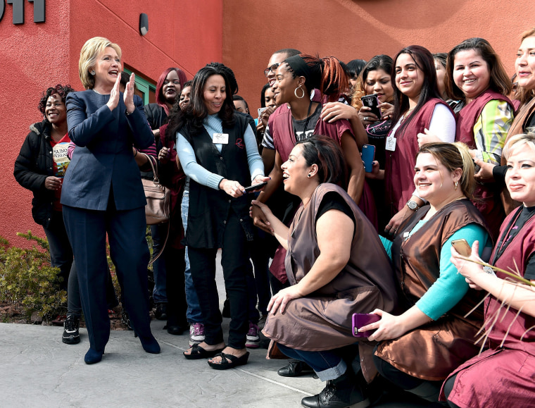Image: Democratic presidential candidate Hillary Clinton greets students from a beauty school in Las Vegas