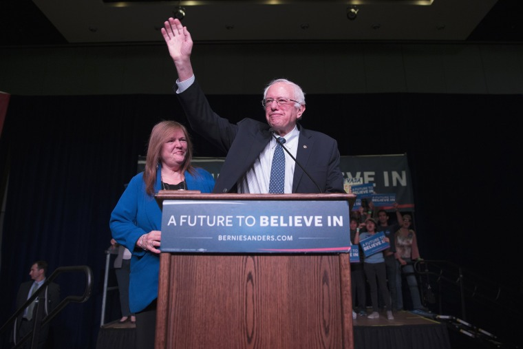 Image: Sen. Bernie Sanders waves after arriving for a canvass kick-off event