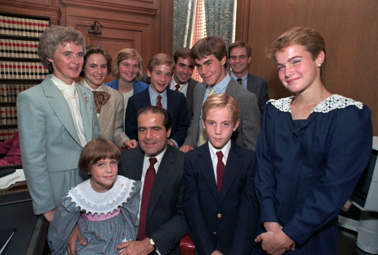 Image: Supreme Court Associate Justice Antonin Scalia poses with his family in his chambers