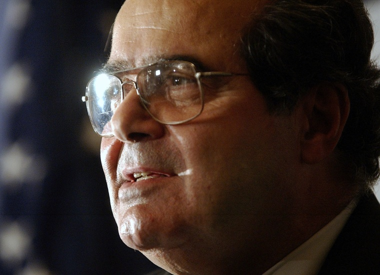 Image: Scalia speaks during a news conference