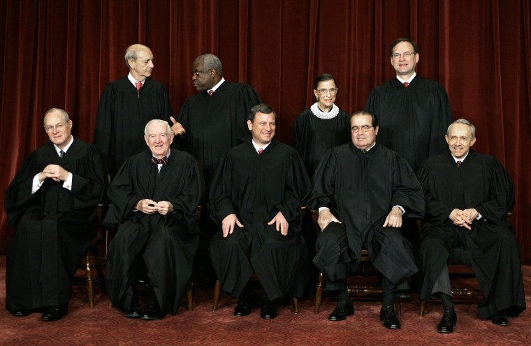Image: The justices of the Supreme Court pose for their class photo