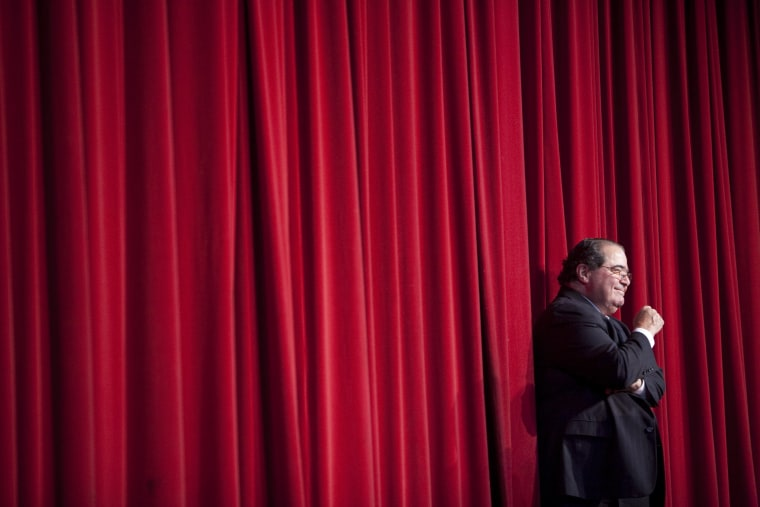 Image: Scalia waits while being introduced before his speech
