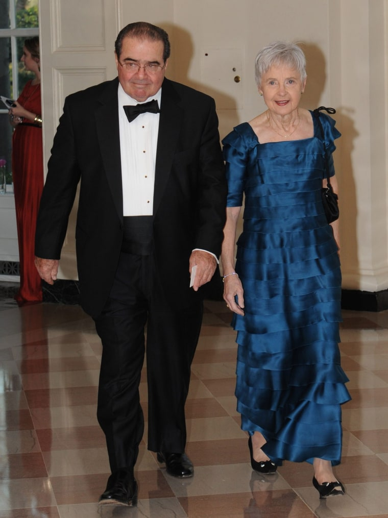 Image: Scalia and his wife Maureen M. Scalia arrive for a State Dinner