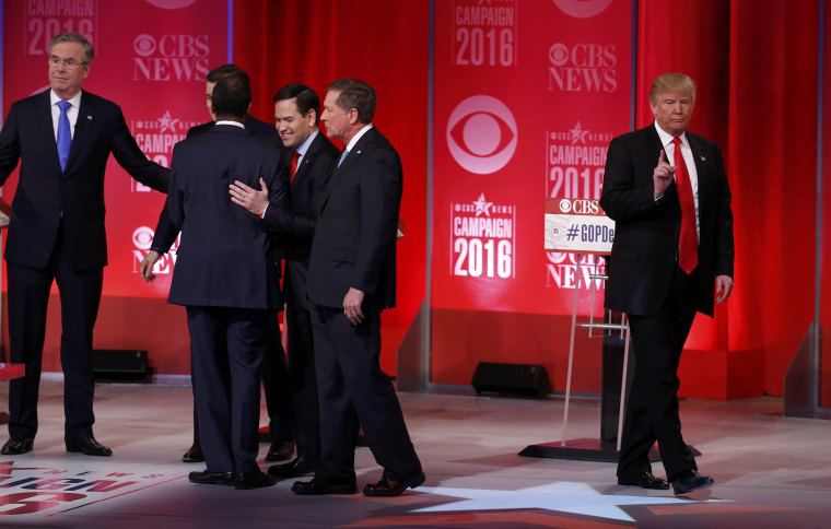 Image: Republican U.S. presidential candidate Trump walks off the stage alone as his rivals shake hands at the conclusion of the Republican U.S. presidential candidates debate sponsored by CBS News and the Republican National Committee in Greenville