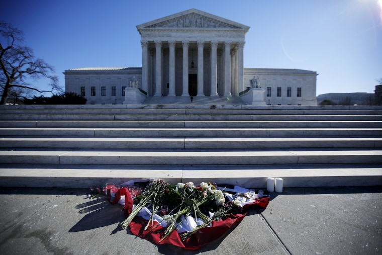 Image: Flowers are seen in front of the Supreme Court building in Washington D.C. after the death of U.S. Supreme Court Justice Antonin Scalia