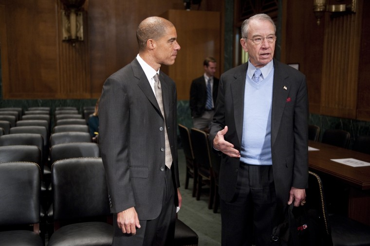 Paul Watford, nominee to be U.S. circuit judge for the Ninth Circuit, speaks with Sen. Chuck Grassley, R-Iowa, on Tuesday, Dec. 13, 2011.