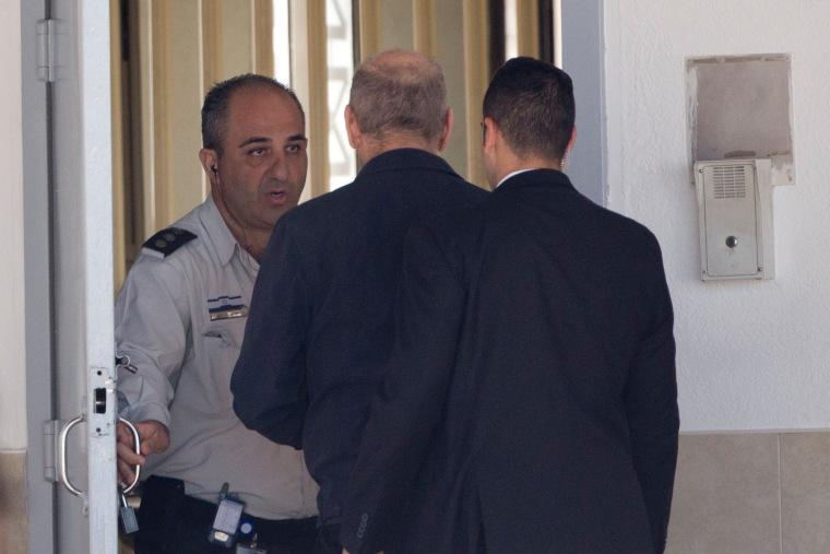 Image: Ehud Olmert enters prison